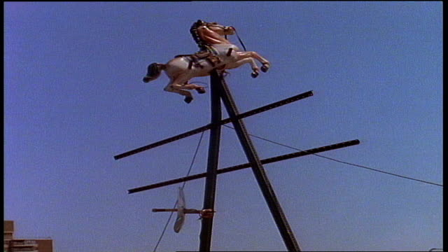 carousel horse on top of antenna in nyc - carousel horse stock videos and b-roll footage
