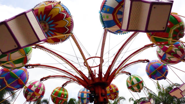 carousel rides at the amusement park - amusement park stock videos & royalty-free footage