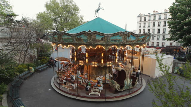 t/l ws ha carousel spinning / paris, france - roundabout stock videos & royalty-free footage