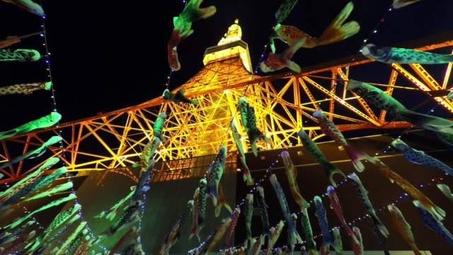 carp streamers of boy's festival at tokyo tower - traditionell festival stock-videos und b-roll-filmmaterial