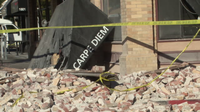 carpe diem bistro is hit by earthquake, rubble and damaged building. - stephenie hollyman stock videos & royalty-free footage