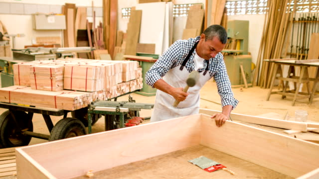 carpenter assembling a piece of furniture - carpentry stock videos & royalty-free footage