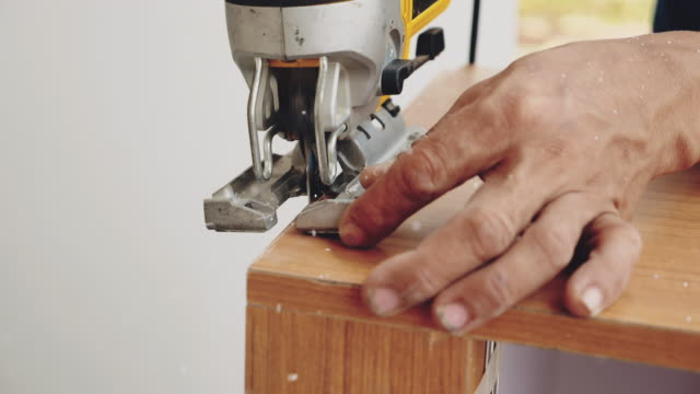 carpenter at work in carpentry workshop - cupboard stock videos & royalty-free footage