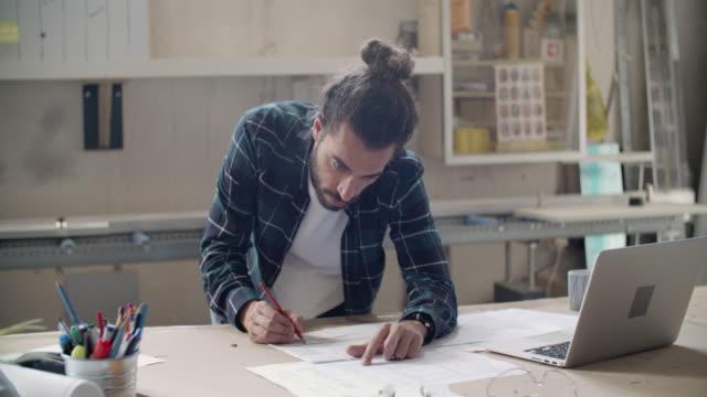 carpenter at work in his workshop - artigianato video stock e b–roll