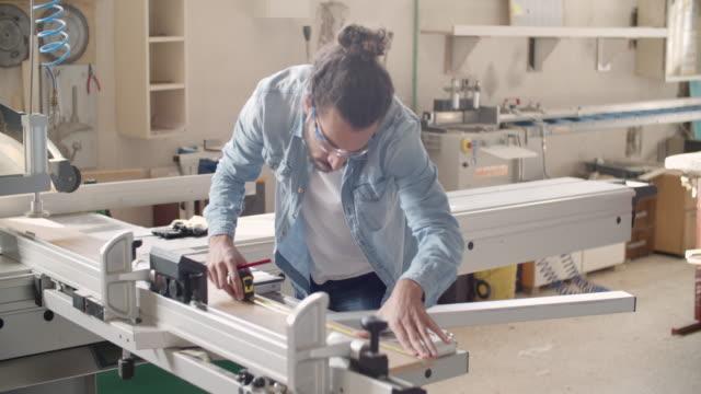 carpenter at work in his workshop - hair bun stock videos & royalty-free footage
