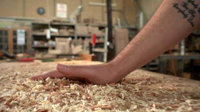 carpenter  brusing off wood shavings - sawdust stock videos and b-roll footage
