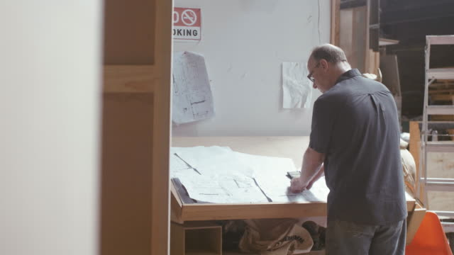 carpenter checking measurements (slow motion) - craftsperson stock videos & royalty-free footage