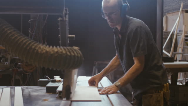 carpenter cutting wood (slow motion) - carpenter stock videos and b-roll footage