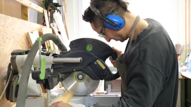 carpenter cutting wood with a circular saw - work tool stock videos & royalty-free footage