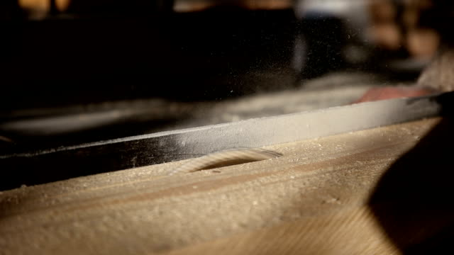 carpenter cutting wooden plank - hand saw stock videos and b-roll footage