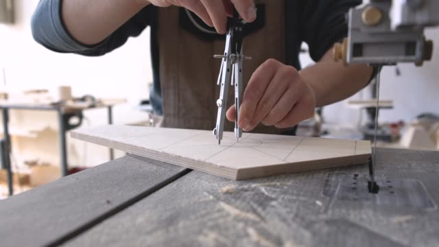 carpenter designing wooden product - drawing compass stock videos & royalty-free footage