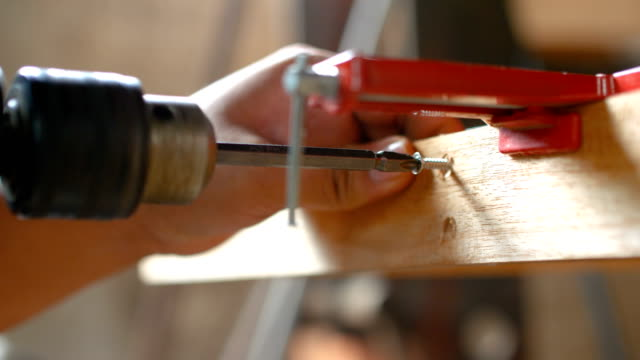 Carpenter Drilling A Hole on Wood, Close-up Dolly shot with Sound