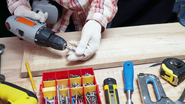 carpenter drilling - drill bit stock videos and b-roll footage