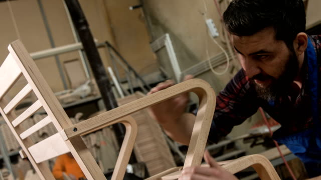 Carpenter Examining The Chair