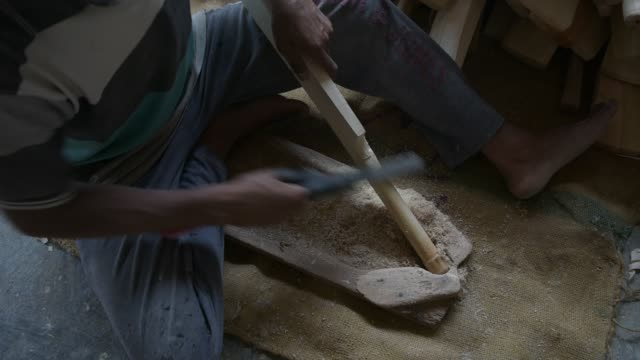 carpenter files handles of cricket bats in a factory on june 08, 2019 in halmullah, 50 km south of srinagar, the summer capital of indian... - durability stock videos & royalty-free footage
