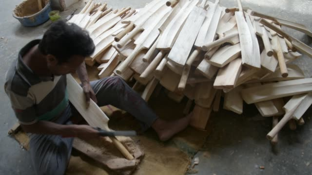 carpenter files handles of cricket bats in a factory on june 08 2019 in halmullah 50 km south of srinagar the summer capital of indian administered... - durability stock videos and b-roll footage