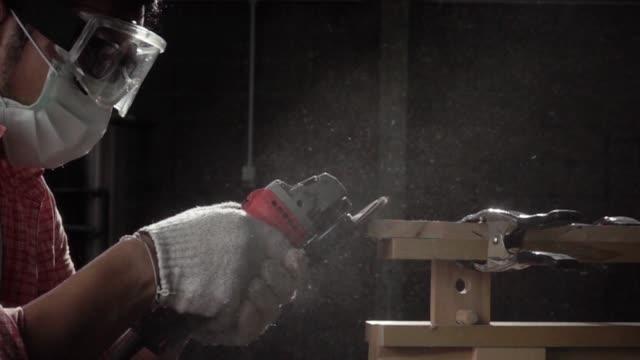 Carpenter grinding wood