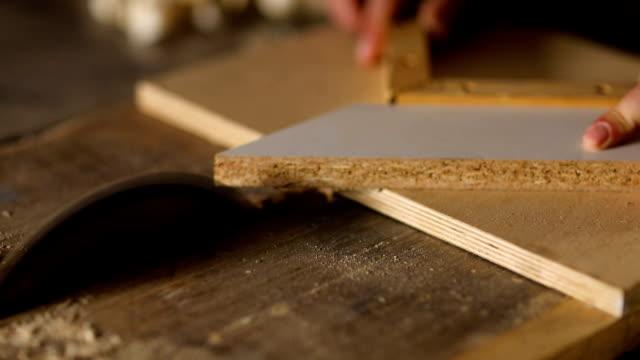 carpenter in his workshop - pensionati lavoratori video stock e b–roll