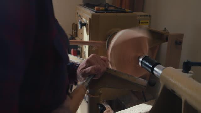 Carpenter in workshop, making bowl