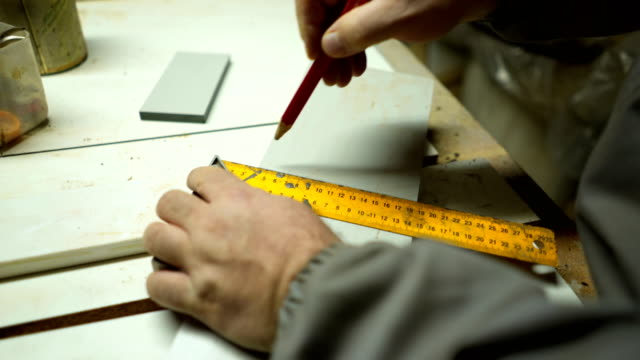 Carpenter  is craft working at a workbench with power tools