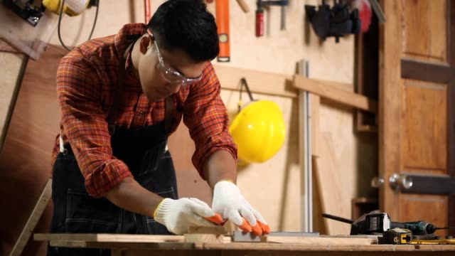 carpenter marking on wood with pencil - glove stock videos & royalty-free footage