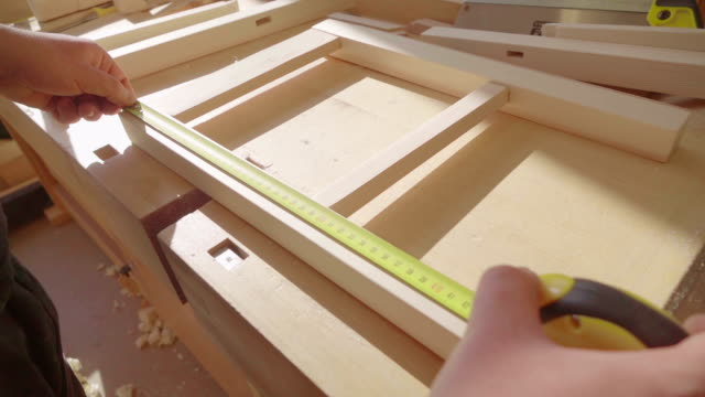 Carpenter measuring a board