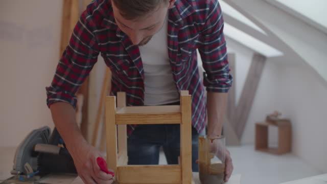 4K: Carpenter painting furniture
