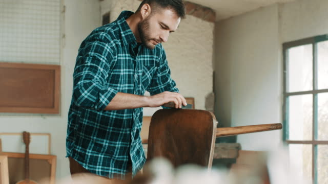 carpenter sanding wooden chair - chair stock videos & royalty-free footage