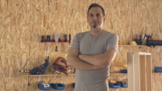 carpenter stands proudly in his furniture shop - standing stock videos & royalty-free footage