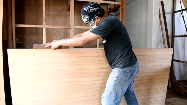 carpenter use a planer sliding of wood  in workshop - industrial designer stock videos & royalty-free footage