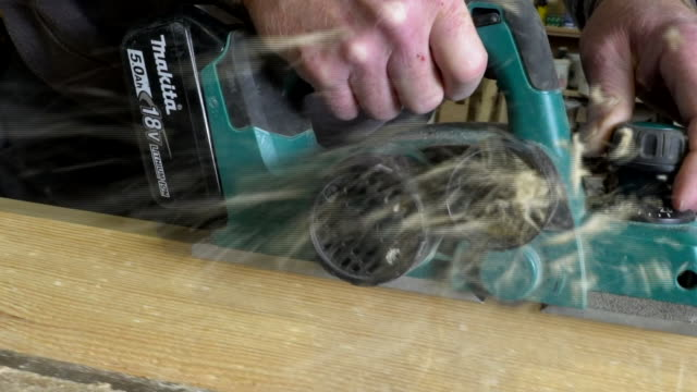 a carpenter using an electric saw on a piece of wood - leicestershire stock videos & royalty-free footage