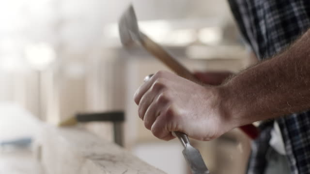 carpenter using chisel at workshop - chisel stock videos and b-roll footage