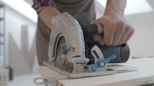 4K: Carpenter Using Circular Saw.