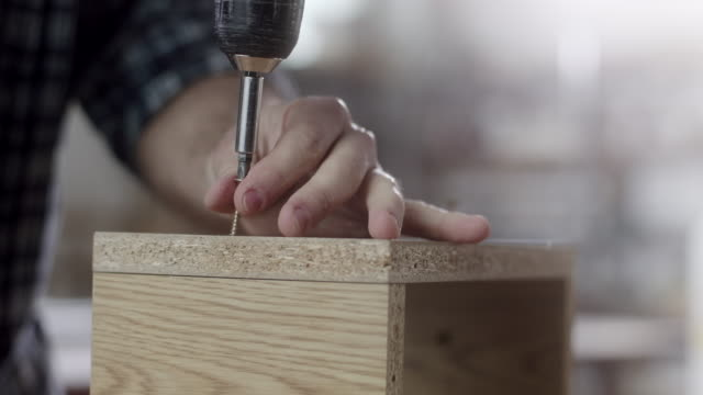 carpenter using drill - professional painter stock videos and b-roll footage