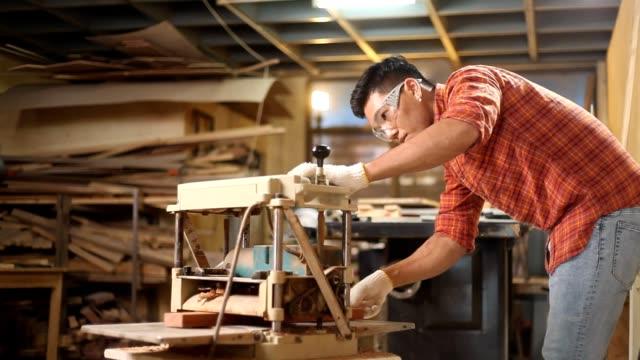 carpenter using planning machine - three quarter length stock videos & royalty-free footage