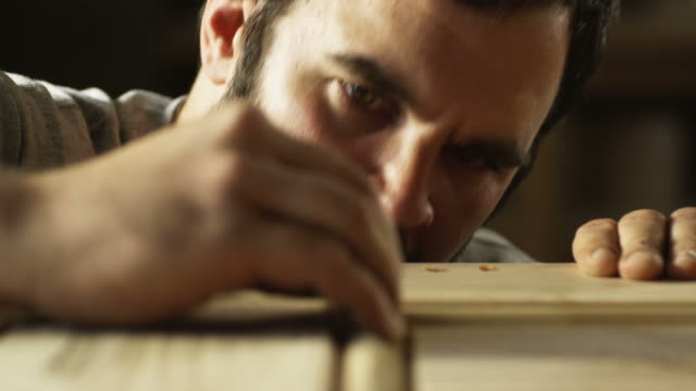 carpenter woodworking on a door - holz stock-videos und b-roll-filmmaterial