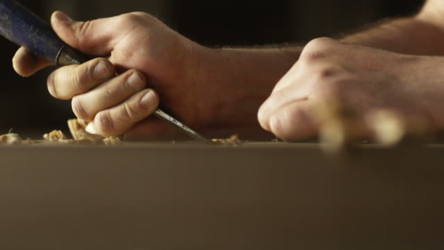 vidéos et rushes de carpenter woodworking on a door - bois