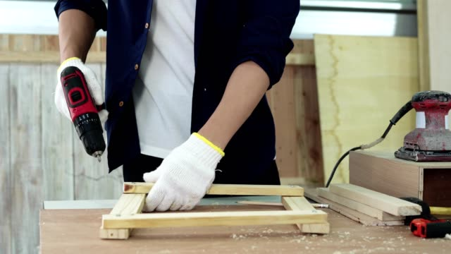 carpenter working design modern furniture in home workshop. - cupboard stock videos & royalty-free footage