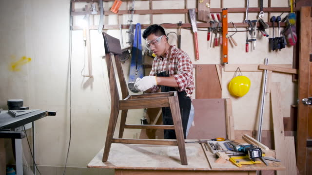 carpenter working in his workshop - one young man only stock videos & royalty-free footage