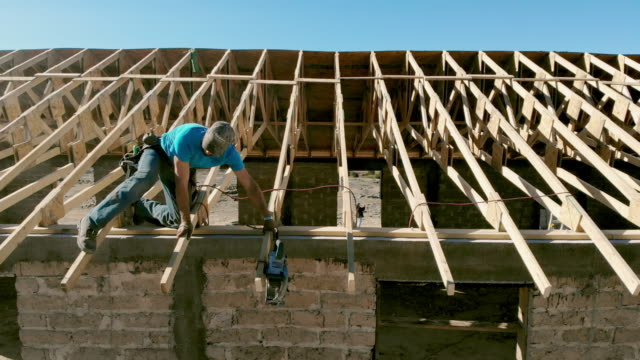 a carpenter working on the roof of a new building - missionary stock videos & royalty-free footage