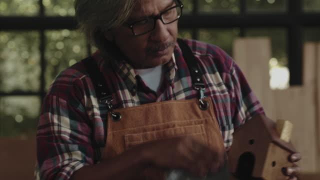 carpenter working - working seniors stock videos & royalty-free footage