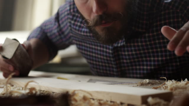 carpenter working with sandpaper - sanding stock videos & royalty-free footage