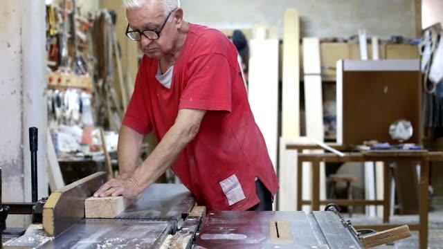Carpenter works in a workshop
