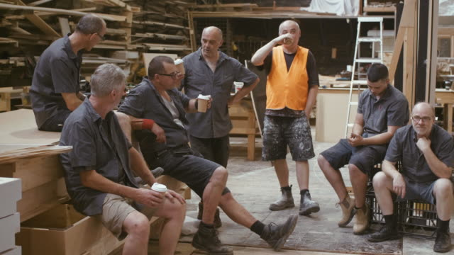 Carpenters are having a coffee break (slow motion)