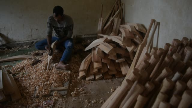 carpenters finishes cricket bats in a factory on june 08, 2019 in halmullah, 50 km south of srinagar, the summer capital of indian administered... - durability stock videos & royalty-free footage