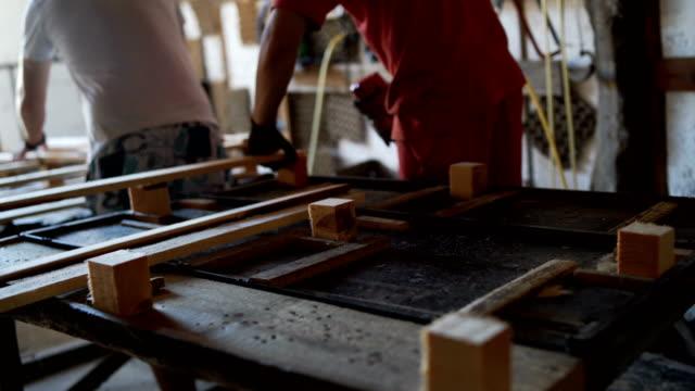 Carpenters in workshop