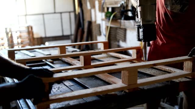 carpenters in workshop - wood material stock videos & royalty-free footage