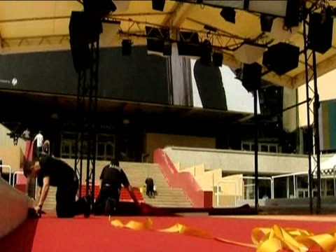 carpenters lay down red carpet ahead of 62nd cannes film festival france; 13 may 2009 - international cannes film festival stock videos & royalty-free footage