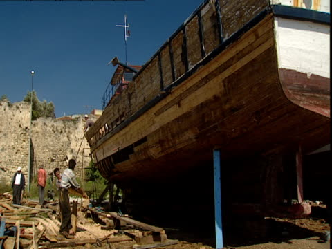 carpenters work on a replica on noah's ark. - ark stock videos and b-roll footage