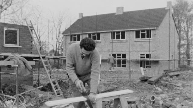 1960 b/w montage carpenters working on housing construction / united kingdom - labor union stock videos and b-roll footage